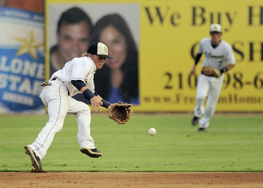O'Connor's Zachary Davenport (left) fields a Corpus Christi King hit as Zachary Galm looks on. King won 2-1 in Game 1 of the best-of-3 series. Photo: Darren Abate / For The Express-News
