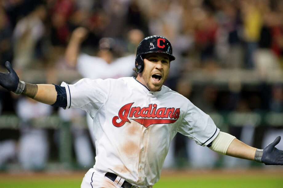 Jason Kipnis didn't have to round the bases after his homer in the bottom of the 10th inning, but did anyway, following a pair of fellow Indians he drove in. Photo: Jason Miller, Stringer / 2013 Getty Images