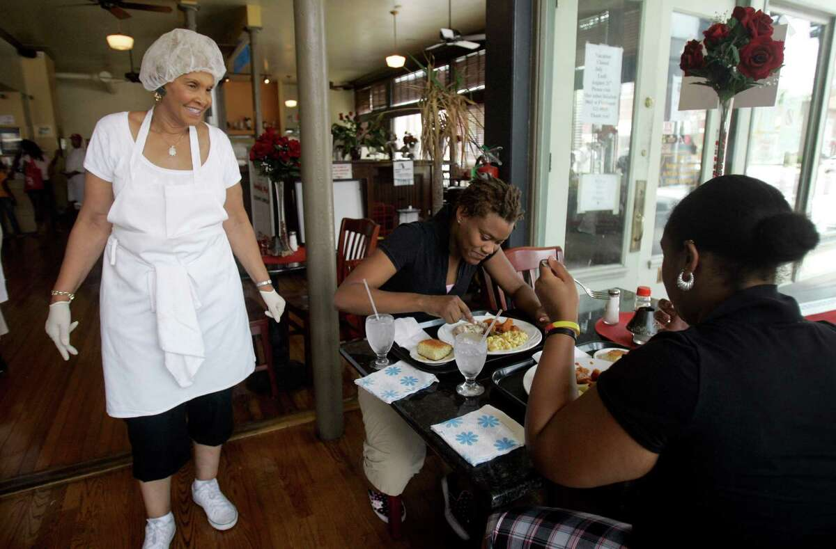 Robbie Montgomery, left, talks to diners Tasha Davis, center, and Sylvona Harvey, right, in Sweetie Pie's, Montgomery's soul food restaurant. A Sweetie Pie's spinoff is expected to open in Houston. >>Keep clicking for a look at the best soul food restaurants in Houston according to Yelp.
