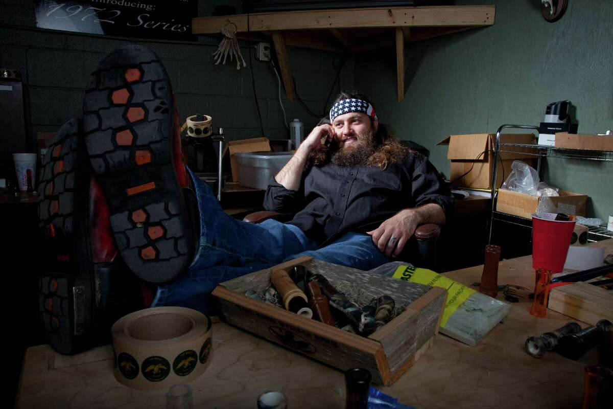 """Willie Robertson, star of A&E's """"Duck Dynasty,"""" lounges at the Duck Commander warehouse in West Monroe, La. Turning owners into stars has become a winning formula for television producers, but some businesses featured in them are cashing in, too."""