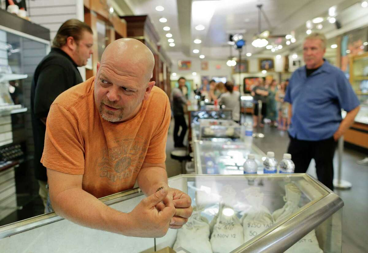 """Rick Harrison, owner of the Gold & Silver Pawn Shop, waits as a camera crew prepares to shoot an episode of """"Pawn Stars."""""""