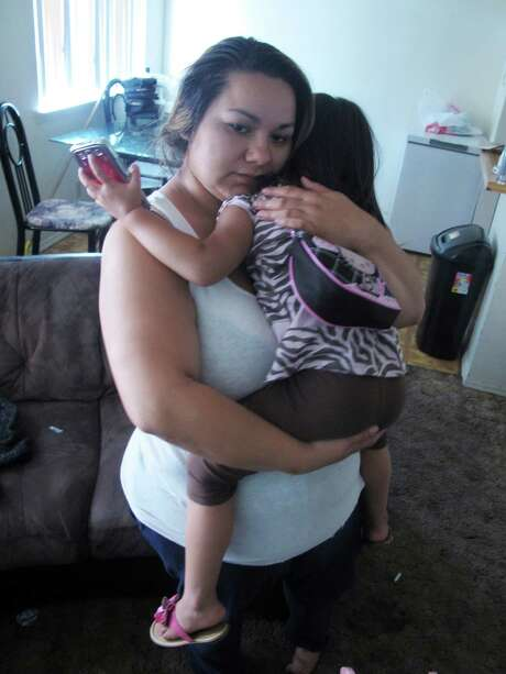Melissa Torrez holds her 4-year-old daughter in her apartment Friday in Albuquerque, N.M. After a chase through the city, Torrez cornered her child's abductor in an apartment complex. She said she then lost control of her car and struck his vehicle. Photo: Russell Contreras / Associated Press