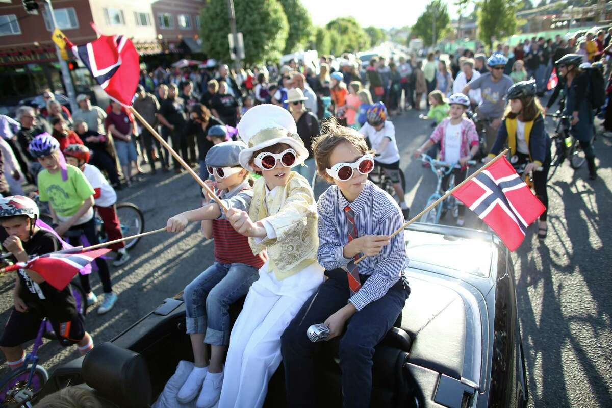 Students from Loyal Heights Elementary ride in a convertible during Ballard's annual Syttende Mai parade. The parade celebrates Norwegian Constitution Day and is one of the largest celebrations outside of Oslo. Photographed on Friday, May 17, 2013.