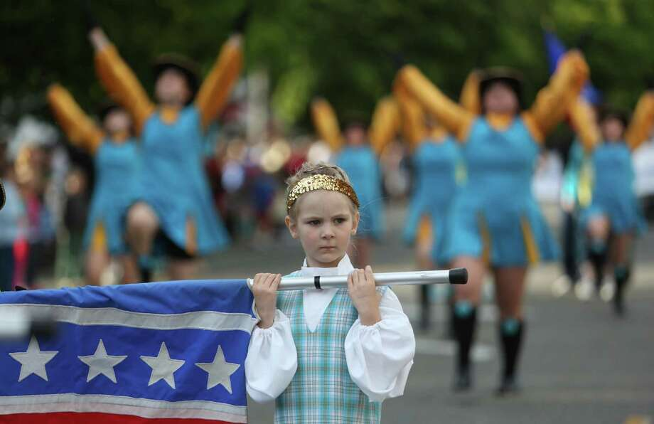 The Ballard Eagles Drill Team performs during Ballard's annual Syttende Mai parade. The parade celebrates Norwegian Constitution Day and is one of the largest celebrations outside of Oslo. Photographed on Friday, May 17, 2013. Photo: JOSHUA TRUJILLO / SEATTLEPI.COM