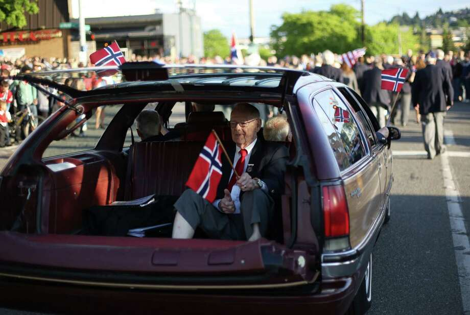 Ted Ormbrek rides with members of the Norwegian Male Chorus during Ballard's annual Syttende Mai parade. The parade celebrates Norwegian Constitution Day and is one of the largest celebrations outside of Oslo. Photographed on Friday, May 17, 2013. Photo: JOSHUA TRUJILLO / SEATTLEPI.COM