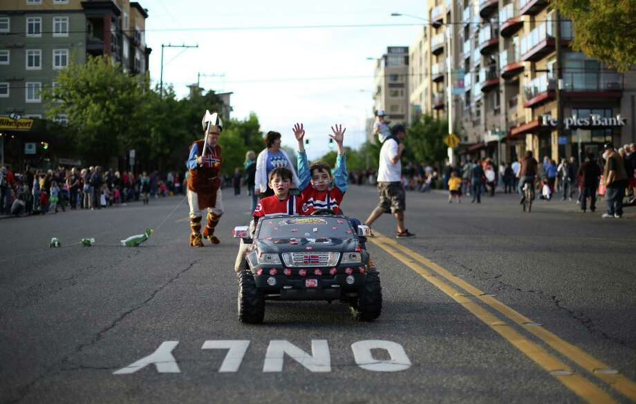 Young participants drive their car during Ballard's annual Syttende Mai parade. The parade celebrates Norwegian Constitution Day and is one of the largest celebrations outside of Oslo. Photographed on Friday, May 17, 2013. Photo: JOSHUA TRUJILLO / SEATTLEPI.COM