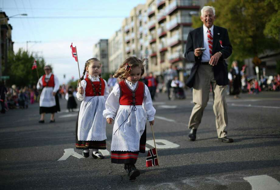 Participants march along the route during Ballard's annual Syttende Mai parade. The parade celebrates Norwegian Constitution Day and is one of the largest celebrations outside of Oslo. Photographed on Friday, May 17, 2013. Photo: JOSHUA TRUJILLO / SEATTLEPI.COM
