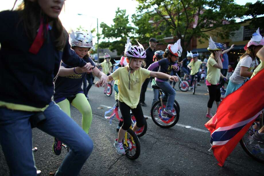 Members of the Whittier Elementary School unicycle team ride along NW Market Street during Ballard's annual Syttende Mai parade. The parade celebrates Norwegian Constitution Day and is one of the largest celebrations outside of Oslo. Photographed on Friday, May 17, 2013. Photo: JOSHUA TRUJILLO / SEATTLEPI.COM