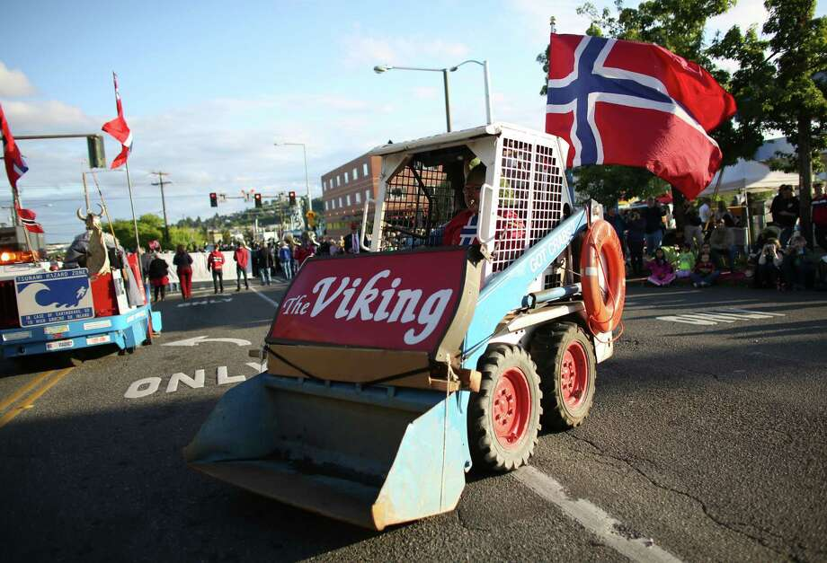 A front end loader carries the sign from the now closed Viking during Ballard's annual Syttende Mai parade. The parade celebrates Norwegian Constitution Day and is one of the largest celebrations outside of Oslo. Photographed on Friday, May 17, 2013. Photo: JOSHUA TRUJILLO / SEATTLEPI.COM