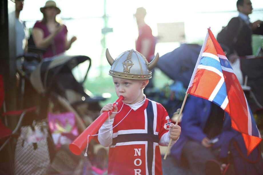 Shaffer Massena, 3, watches the action during Ballard's annual Syttende Mai parade. The parade celebrates Norwegian Constitution Day and is one of the largest celebrations outside of Oslo. Photographed on Friday, May 17, 2013. Photo: JOSHUA TRUJILLO / SEATTLEPI.COM