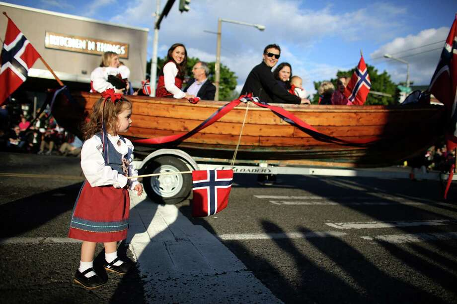Ada Ferkingstead, 2, marches along during Ballard's annual Syttende Mai parade. The parade celebrates Norwegian Constitution Day and is one of the largest celebrations outside of Oslo. Photographed on Friday, May 17, 2013. Photo: JOSHUA TRUJILLO / SEATTLEPI.COM