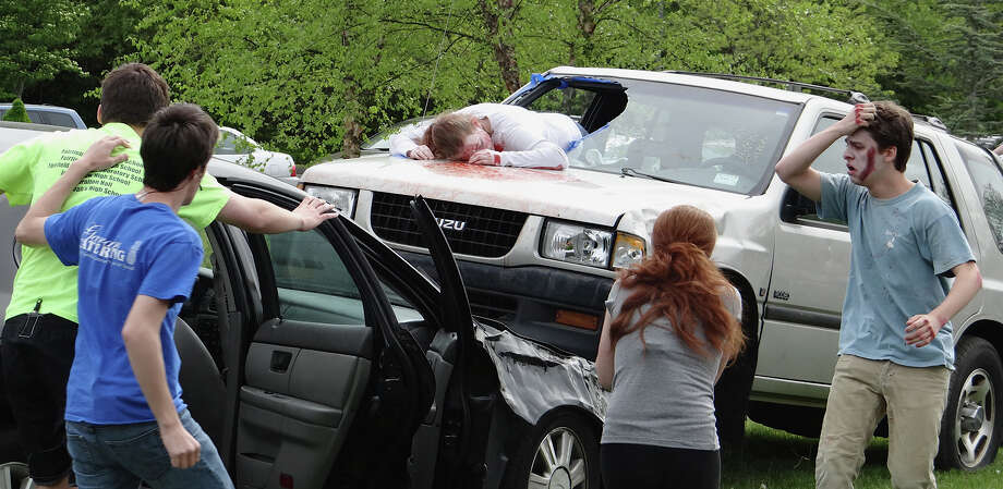 """Student """"victims"""" at mock auto accident scene Friday at Fairfield Warde High School. Photo: Mike Lauterborn / Fairfield Citizen contributed"""