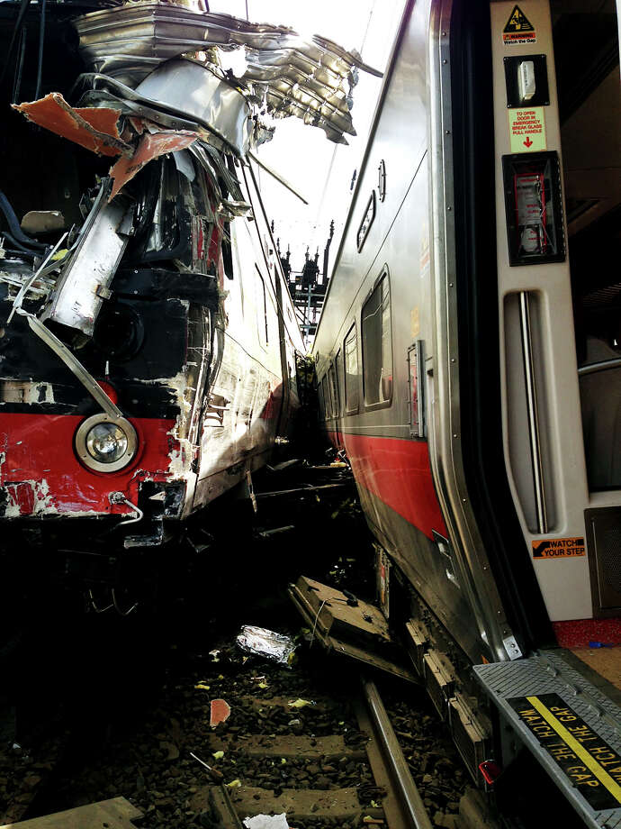 May 2013: Investigators from National Transportation Safety Board have arrived in Bridgeport on Saturday May 18, 2013 to find the cause of Friday evening's Metro-North train collision that left more than 60 people injured. . NTSB member Earl Weene said the investigation is focusing on a variety of focal areas including braking performance, condition of wheels, condition of tracks and signals. Photo: Contributed Photo/Adam Wood/City, Contributed Photo/City Of Brodge / Connecticut Post contributed
