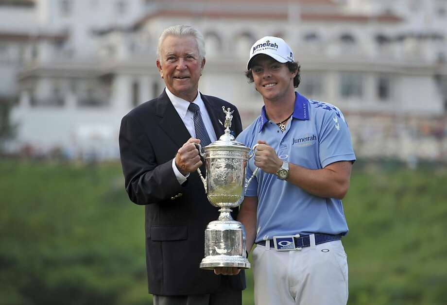 In this June 19, 2011, file photo, 2011 U.S. Open golf tournament champion Rory McIlroy holds his trophy with former winner Ken Venturi in Bethesda, Md. Venturi, who overcame dehydration to win the 1964 U.S. Open and spent 35 years in the booth for CBS Sports, died Friday afternoon, May 17, 2013. He was 82. His son, Matt Venturi, said he died in a hospital in Rancho Mirage, Calif.  Photo: Larry French, Associated Press