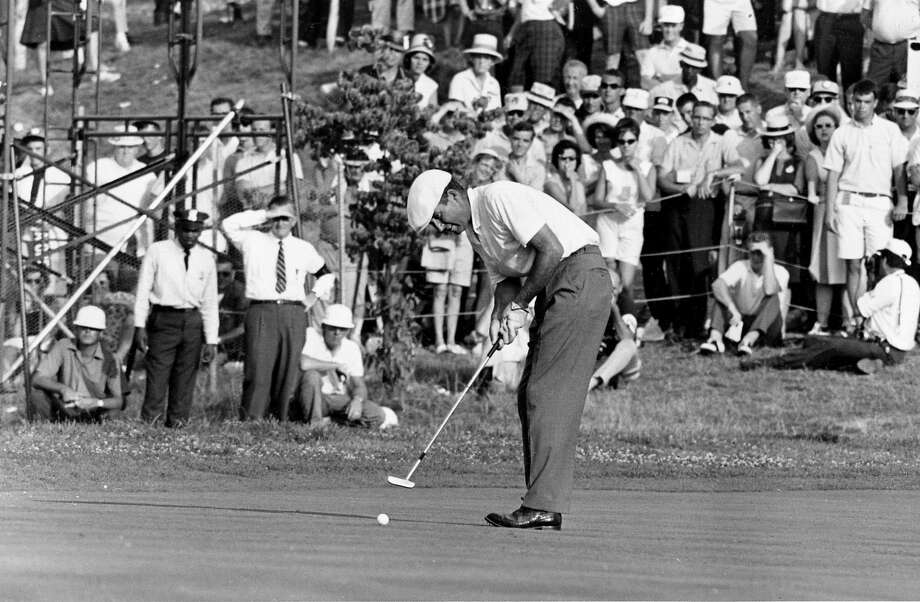 File-This June 20, 1964 file photo shows Ken Venturi making the final putt on the 18th green during the U.S. Open Golf Championship at Congressional Country Club in Bethesda, Md. The former U.S. Open champion has died just 12 days after he was inducted into the World Golf Hall of Fame. He was 82. His son, Matt Venturi, says he died Friday May 17, 2013 in a hospital in Rancho Mirage, Calif. Venturi had been hospitalized the last two months for a spinal infection, pneumonia and an intestinal infection.  Photo: Associated Press