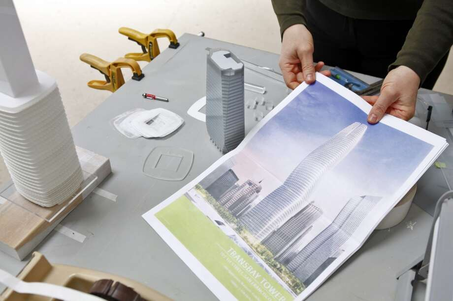 Lisa Gemmitti shows a drawing of the new model of the Transbay Tower that is being made into a model. The artists at Gemmiti Model Art are working on the creation of a model of the new Transbay Tower in their San Francisco, Calif., offices on Monday, April 15, 2013.