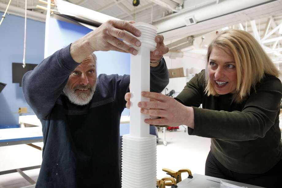 Lisa Gemmitti, right, and Andy Eckers assemble the floor layers of the new model of the Transbay Tower. The artists at Gemmiti Model Art are working on the creation of a model of the new Transbay Tower in their San Francisco, Calif., offices on Monday, April 15, 2013.