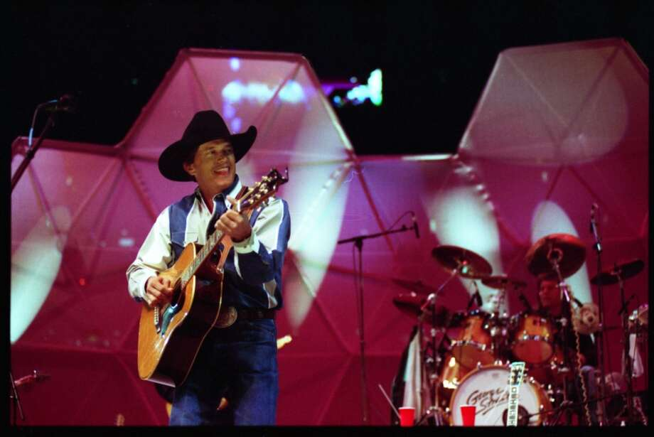 George Strait performs at the Houston Livestock Show & Rodeo in the Houston Astrodome in 1995.