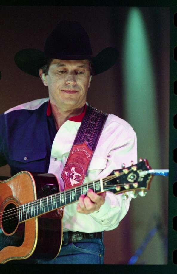 George Strait performs at the Houston Livestock Show & Rodeo in the Houston Astrodome in 1996.