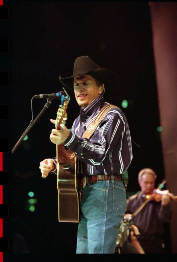 George Strait performs at the Houston Livestock Show & Rodeo in the Houston Astrodome in 1997.