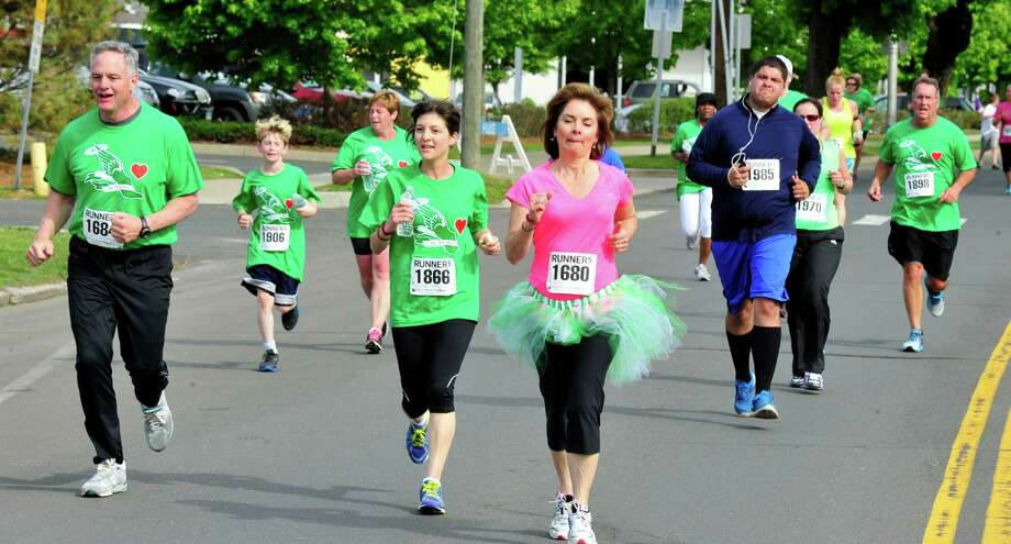 This is the Spring Forward 4 Sandy Hook 5K race held in Danbury, Conn. Saturday, May 18, 2013. The event raises money for scholarships in Dawn Hochsprung and Lauren Rousseau's memory. Both were killed in the Sandy Hook Elementry School tragedy. Photo: Michael Duffy / The News-Times