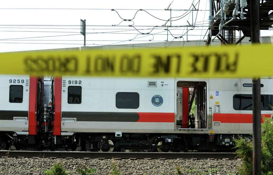Police tape blocks off the area around the scene of the May 17, 2013, Metro-North train collision that left more than 60 people injured.  Photo: Cathy Zuraw / Connecticut Post
