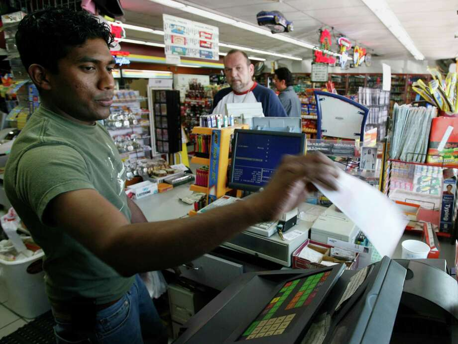 6. $390.0 million, Mega Millions, March 6, 2007 (2 tickets from Georgia and New Jersey)Gayashana Prasath sells Mega Millions Lottery quick picks to Homero Escobar for the March 6, 2007, at the Sunrise Grocery store in Houston's Woodland Heights neighborhood. Photo: Kevin Fujii, Houston Chronicle / Houston Chronicle