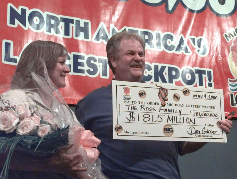 9. $363.0 million, The Big Game, May 9, 2000 (2 tickets from Illinois and Michigan)Larry and Nancy Ross of Shelby Township, Mich., pose with their presentation check of $181.5 million as one of two winners of the Big Game lottery during a news conference Friday, May 12, 2000, in Lansing, Mich. Photo: DALE ATKINS, AP / AP