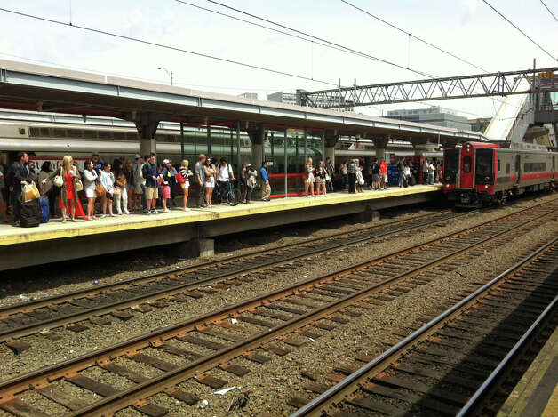 Commuters wait on the platform at the Stamford station for a train to New York. Metro-North service has been indefinitely suspended between South Norwalk and New Haven forcing many Outer New Haven Line passnegers to make alternate transortation plans. Photo: Kate King