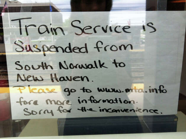 A sign infoming customers of service disruptions hangs at the Greenwich train station. Metro-North service has been indefinitely suspended between South Norwalk and New Haven forcing many Outer New Haven Line passnegers to make alternate transortation plans. Photo: Kate King