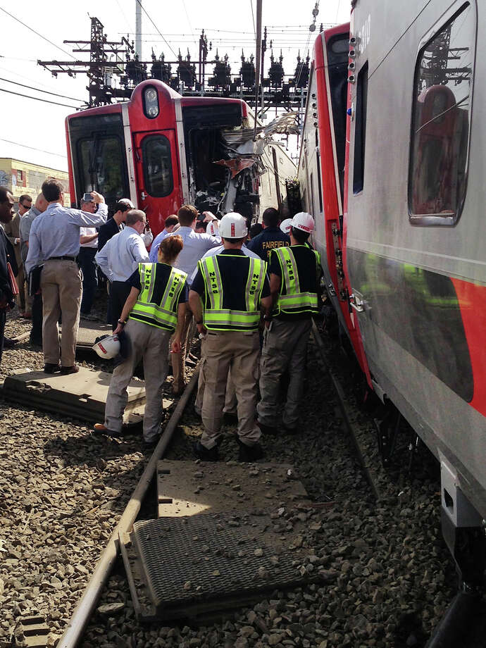 May 2013: -Investigators from National Transportation Safety Board in Bridgeport, Conn. on Saturday May 18, 2013 to find the cause of Friday evening's Metro-North train collision that left more than 60 people injured. Gov. Dannel P. Malloy joined NTSB representatives to tour the area of the crash. Photo: Contributed Photo\City Of Bridge, Contributed Photo / Connecticut Post contributed