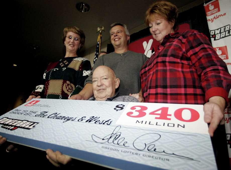 10. $340.0 million, Powerball, Oct. 19, 2005 (1 ticket from Oregon)Bob Chaney, seated, is joined by, from background left, his wife, Frances Chaney; son-in-law, Steve West; and daughter, Carolyn West; as they hold a ceremonial check at the Oregon Lottery Commission Tuesday, Nov. 8, 2005, in Salem, Ore. Photo: RICK BOWMER, AP / AP