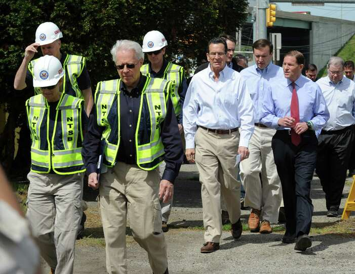 Investigators from National Transportation Safety Board, Gov. Dannel Malloy, Senators Chris Murphy a