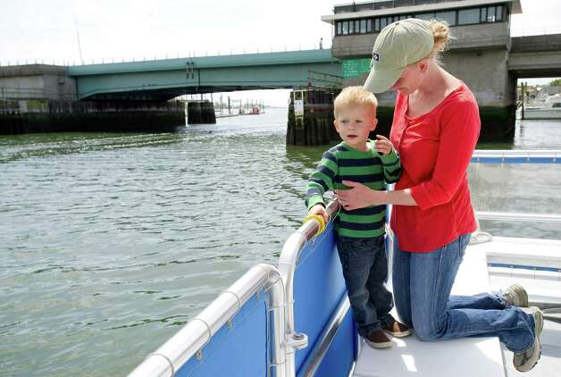 "Nancy Grimm holds her son, Samuel, 3, on board ""The CJ Toth"" during the Norwalk Seaport Association's Commissioning Day event to open the season in Norwalk, Conn., on Saturday, May 18, 2013. Photo: Lindsay Perry / Stamford Advocate"