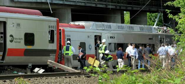 Investigators from National Transportation Safety Board and officials were in  Bridgeport, Conn. on Saturday May 18, 2013 to tour the area of Friday evening's Metro-North train collision that left more than 60 people injured. Photo: Cathy Zuraw / Connecticut Post