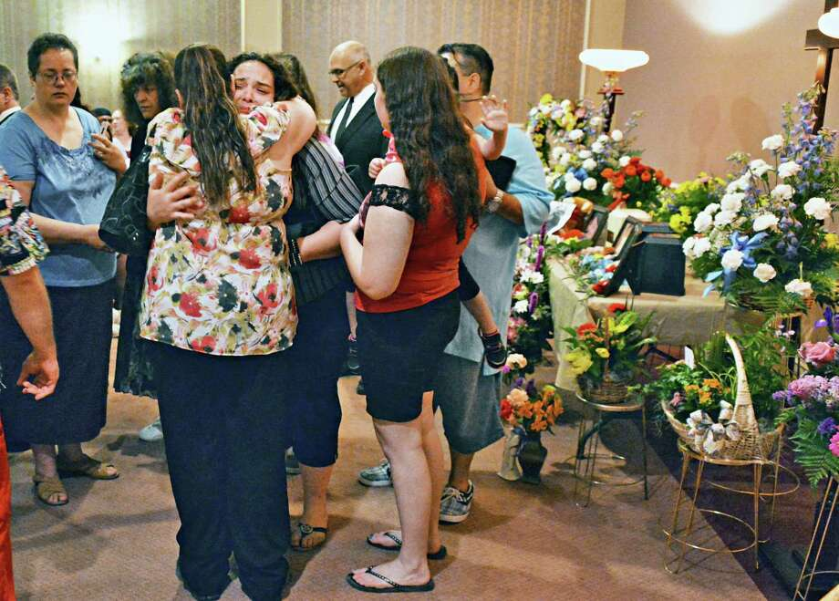 Mourners at a memorial service for the Terry family, lost in a fatal house fire earlier this month,  at Bond Funeral Home in Schenectady, NY Saturday May 18, 2013.  (John Carl D'Annibale / Times Union) Photo: John Carl D'Annibale / 00022472A
