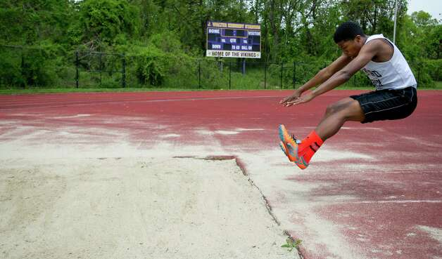Stamford's Devin Davis competes in the long jump during Saturday's city track championship meet at Westhill High School on May 18, 2013. Photo: Lindsay Perry / Stamford Advocate