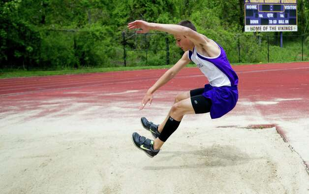 Westhill's Billy Thibault competes in the long jump during Saturday's city track championship meet at Westhill High School on May 18, 2013. Photo: Lindsay Perry / Stamford Advocate