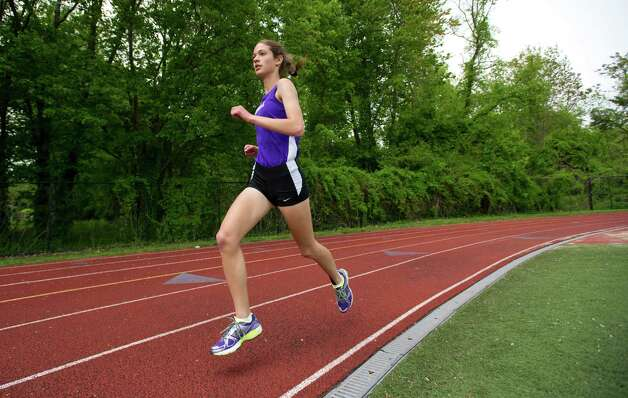 Westhill's Claire Howlett runs during Saturday's city track championship meet at Westhill High School on May 18, 2013. Photo: Lindsay Perry / Stamford Advocate