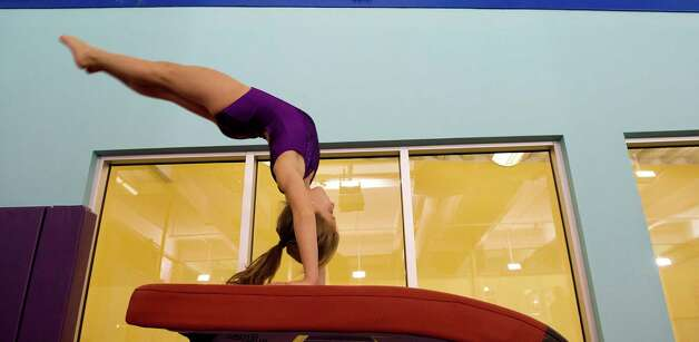 Jackie Erensen practices on the vault at Chelsea Piers Connecticut on March 12, 2013. Photo: Lindsay Perry / Stamford Advocate