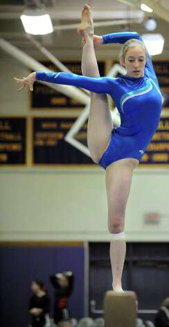 A gymnast competes during the FCIAC championships at Westhill High School on February 16, 2013. Photo: Lindsay Perry / Stamford Advocate