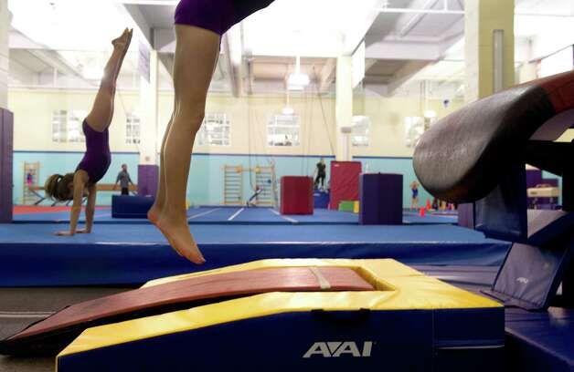 Gymnasts practice at Chelsea Piers Connecticut on March 12, 2013. Photo: Lindsay Perry / Stamford Advocate