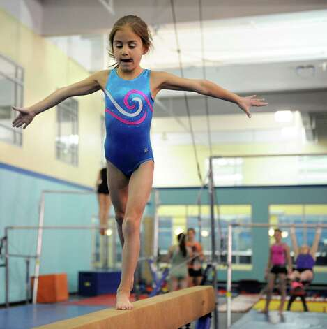 Marissa Grecco practices on the balance beam at Chelsea Piers Connecticut on February 21, 2013. Photo: Lindsay Perry / Stamford Advocate