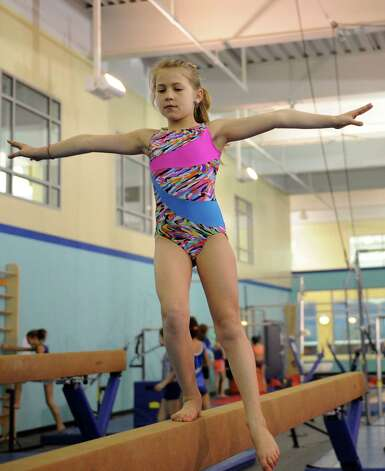 Jackie Erensen practices on the balance beam at Chelsea Piers Connecticut on February 21, 2013. Photo: Lindsay Perry / Stamford Advocate