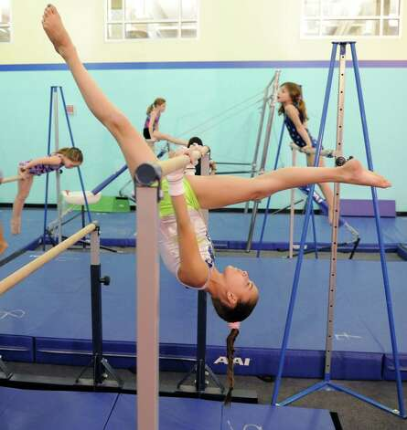 Alexa Grecco practices on the uneven bars at Chelsea Piers Connecticut on February 21, 2013. Photo: Lindsay Perry / Stamford Advocate