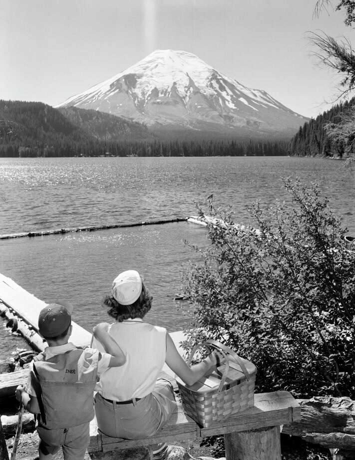 Mount St. Helens and Spirit Lake, mother and son looking at view Photo: SuperStock, Getty Images/SuperStock RM / SuperStock RM