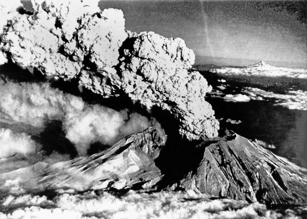 An eruption column rises from Mount St. Helens, Washington, 22nd July 1980. This was one of a series of explosive eruptions by the volcano in 1980, the most destructve occurring on 18th May and causing the entire north face (nearest camera) to slide away. In the background (right) is the stratovolcano Mount Hood, Oregon.