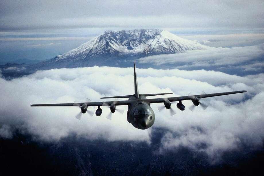 A C-130 Hercules  flies away from Mount St. Helens. Photo: Purestock, Getty Images/Purestock / Purestock