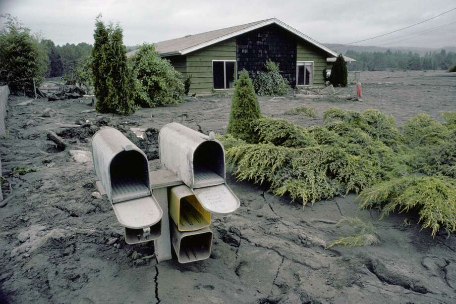 Mailbox and house left in ruins by the 1980 eruption of Mount St. Helens. Photo: James Balog, Getty Images/Aurora Creative / Aurora Creative