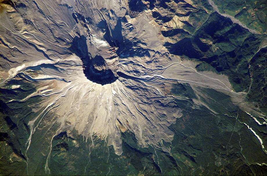 The devastating effects of the eruption are clearly visible in this 2002 photo from the International Space Station. Photo: Science & Society Picture Librar, SSPL Via Getty Images / These images are for viewing purposes only. Their copyright belongs to the photographer . Their delivery does not constitute a right to use. Reproduction rights must be ordered, or permission obtained in writing, if ANY use at all is made of any of these images. Precise reproduction rights and relevant fees for each usage must be agreed before any use is made of the pictures.   RIGHTS TO STORE, TRANSMIT OR REPRODUCE THESE IMAGES IN ANY FORM (ELECTRONIC OR OTHERWISE), OR TO MAKE DUPLICATES, MUST BE NEGOTIATED SEPARATELY.